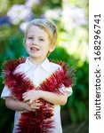 little boy with tinsel wrapped...   Shutterstock . vector #168296741