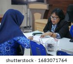 Small photo of Tarakan/Indonesia-03212020: A female Indonesian civil servant is conducting a performance reporting assistance on March 21, 2020 in Tarakan, Indonesia