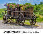 An Antique Farm Cart With Old...
