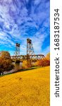 Small photo of Portrait shot of a bridge overtop a lake canal in Lathrop California
