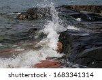 Waves Hitting Rocks In Helsink...