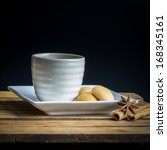 Still life, White tea cup and crackers in white plate  and cinamon - stock photo