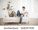cheerful couple reading books... | Shutterstock . vector #168357434