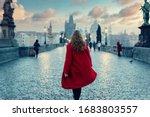 Woman In Red Coat Walking On...