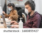 Small photo of Coronavirus. Business workers working from home wearing protective mask. Small company in quarantine for coronavirus working from home with sanitizer gel. Small company concept.