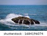 Wave Crashing Over Ocean Rock...