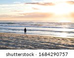 Silhouette Of A Woman At The...