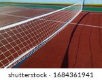 tennis net in the morning low...