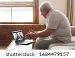 Happy elderly mature 80s man...