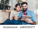 Smiling Couple Using Digital...