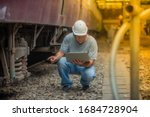 Asian Railroad Engineer Wearin...