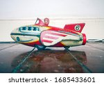 Retro rocket toy with girl...