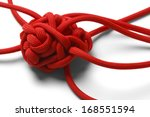 red rope in a tangled mess... | Shutterstock . vector #168551594