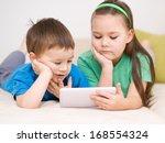 happy children using tablet... | Shutterstock . vector #168554324