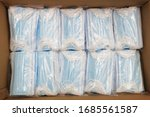 Small photo of Due to the shortage of medical supplies due to the Coronavirus COVID-19 epidemic, there are many medical masks in boxes ready for shipment