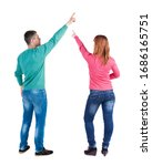 back view of couple in sweater... | Shutterstock . vector #1686165751