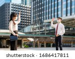 Small photo of Asian business man and woman greet and say hello with business colleague and wearing mask standing distance of 1 meter distance protect from COVID-19 viruses for social distancing for infection risk