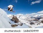 jumping snowboarder keeps one... | Shutterstock . vector #168650999