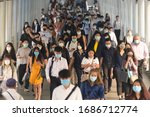 Small photo of BKK THAILAND, 16 Mar 2020 :Group of many salary man wearing face mask for protect coronavirus in air while going to their workplace during coronavirus outbreak crisis in Bangkok at morning rush hour.