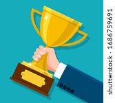 business hand holding trophy.... | Shutterstock .eps vector #1686759691