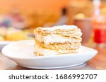 Small photo of Mil hojas cake in white plate