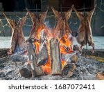 Argentinian asado. An asado is a roasted meat of beef or various other meats, which are cooked on a typical barbecue with vertical grills placed around at fire