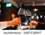Two bartender enjoying of Cheers glass of wine for wine tasting event in a restaurant  at sunset. bartender, tasting, Dinner, Wine, beverage, dinner concept.