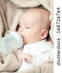 newborn baby sucking bottle | Shutterstock . vector #168726764