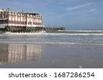 Building Sits On Wooden Pier...