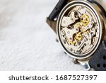 A vintage complicated mechanical watch movement. Showing cogs, wheels, jewels and springs. Left side space for copy text. - stock photo