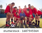 Small photo of Coach With Digital Tablet Discussing Tactics With Womens Football Team Training For Soccer Match