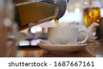 pouring hot tea into the... | Shutterstock . vector #1687667161