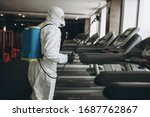 Small photo of Cleaning and Disinfection in crowded places amid the coronavirus epidemic Gym cleaning and disinfection Infection prevention and control of epidemic. Protective suit and mask and spray bag