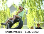 Young Girl On Tire Swing