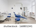 Interior of a dental office, white and blue furniture - stock photo