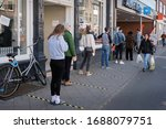 Small photo of Utrecht, Netherlands - March 28 2020: Social distancing (1.5 meter) at a supermarket entrance during the Corona crisis. The supermarket Albert Heijn is owned and operated by Ahold.