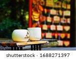Tea cups and Ema board background, Nonomiya Shrine, Kyoto, Japan, In 2015 Summer.