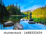 Mountain lake water stones landscape. Mountain lake water. Lake in mountains. Mountain lake stones