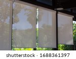 Roller Blinds At The Glass...