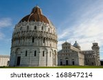 ITALY - MARCH 4: The Pisa Bapistery in Piazza dei Miracoli with the Pisa Cathedral and Leaning Tower of Pisa in the background in Pisa, Italy.