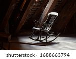Old Rocking Chair On A Dim...