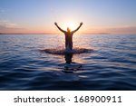 swimmer jumping out of sea... | Shutterstock . vector #168900911
