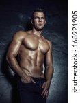 handsome muscular man posing.   Shutterstock . vector #168921905