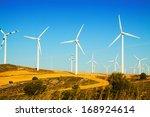 wind farm at farmland in summer.... | Shutterstock . vector #168924614