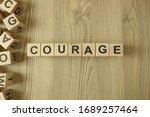 Word Courage From Wooden Block...