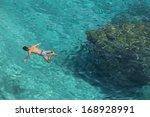 unrecognizable man snorkeling...   Shutterstock . vector #168928991