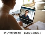 Young Female Sit At Desk At...