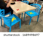 Small photo of Singapore Apr2020 Social distancing rules in practice, alternate seating in public food courts (restaurants, food outlets), to reduce risk of further transmission; people observing safety measures