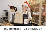 Smiling Young Asian Barista In...
