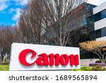 Canon Logo On Sign Post At...